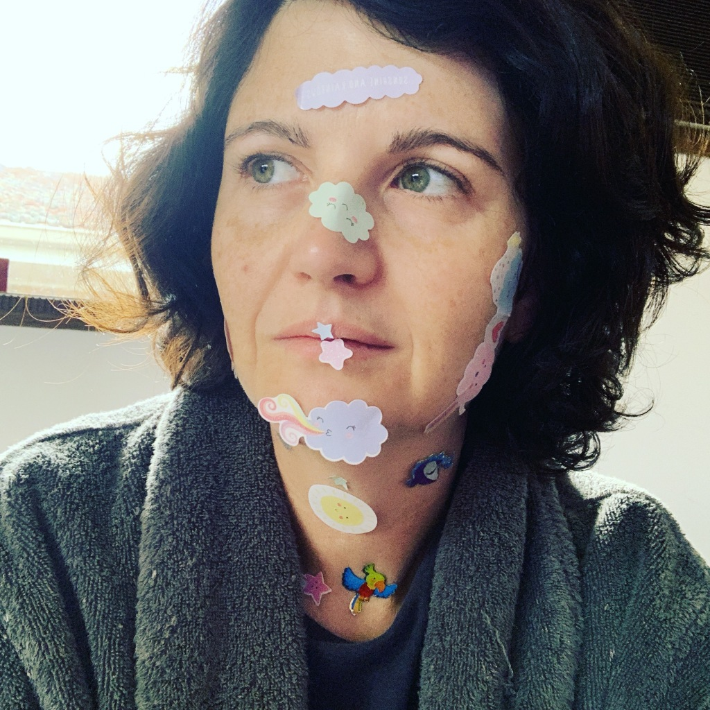 Image of Shelley with stickers on her face